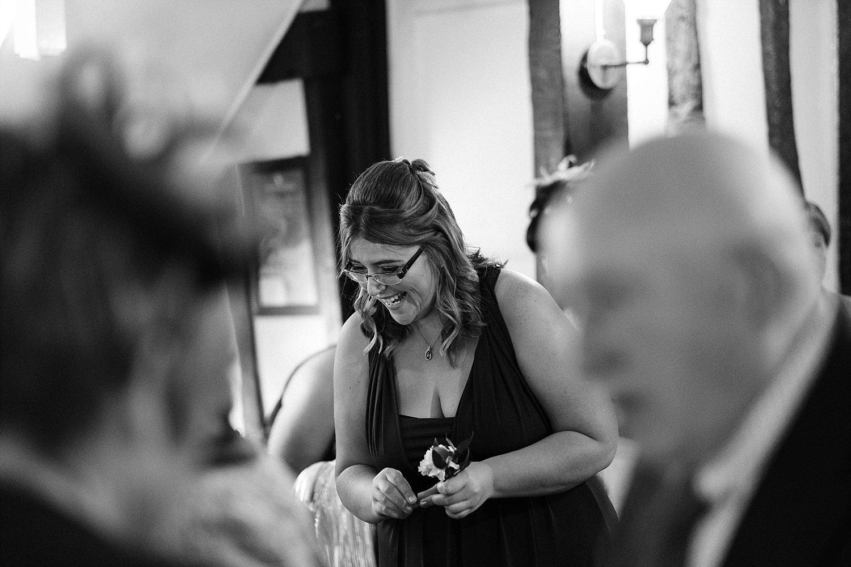bridesmaid laughing at Essex wedding venue