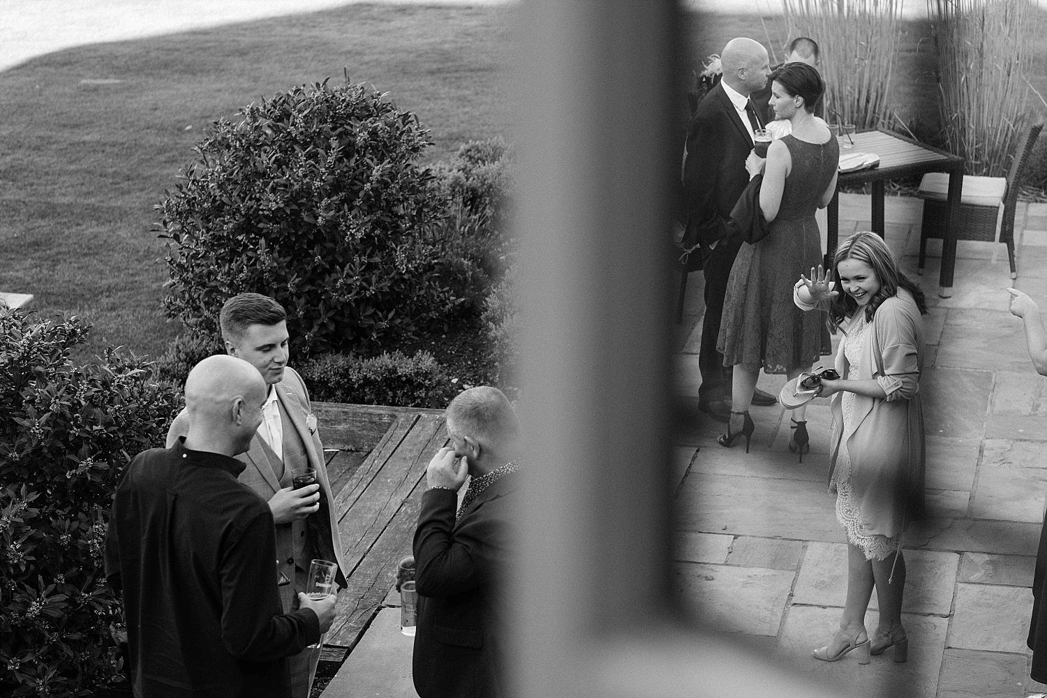 guests enjoying a drink at the warren estate