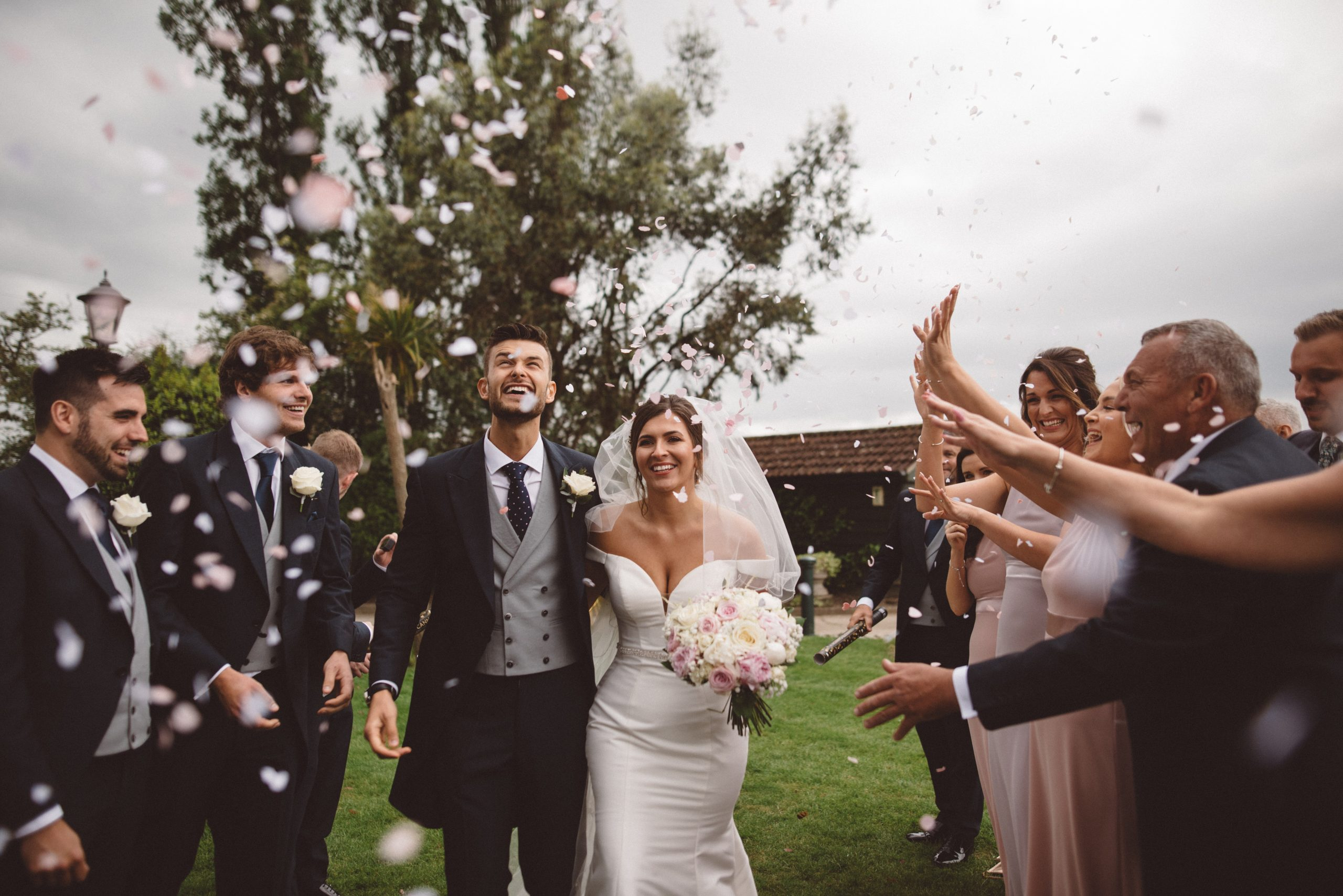 bride, groom and confetti at Friern Manor