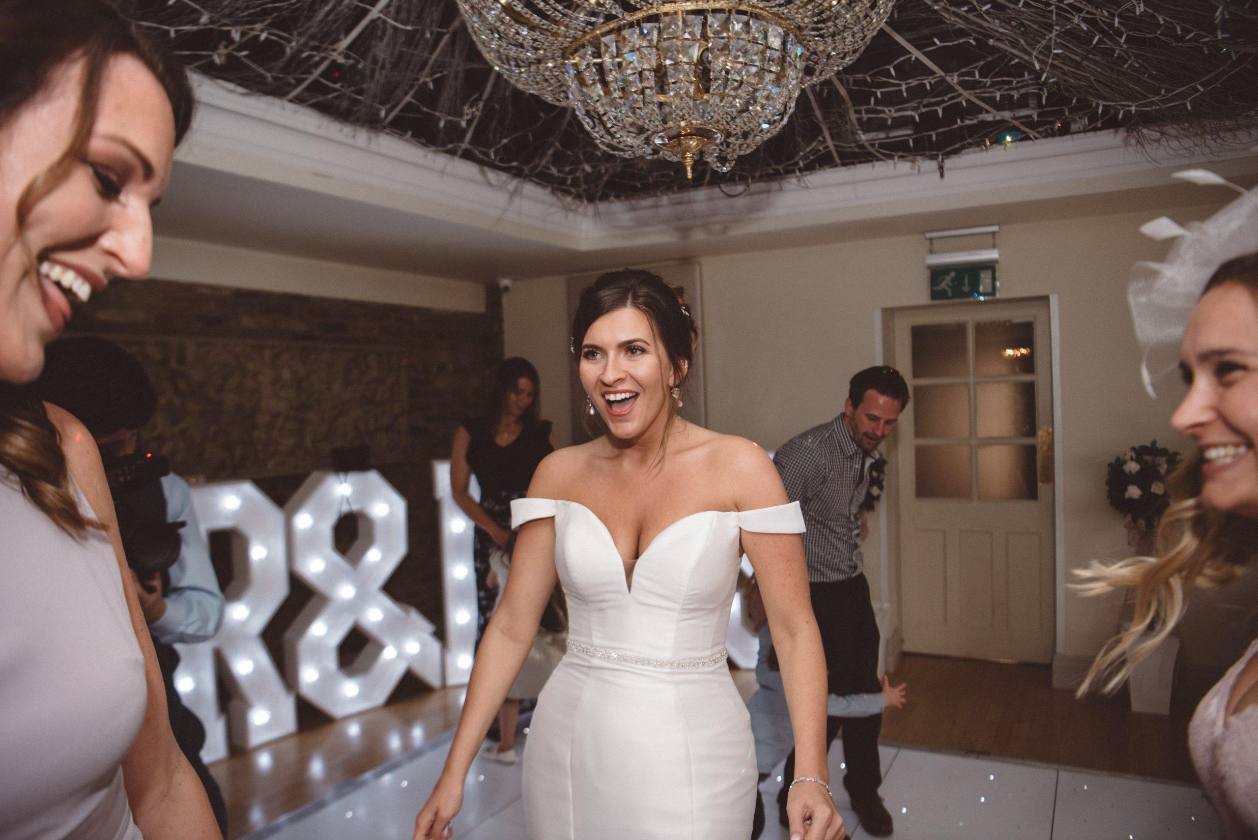 fun happy bride at her Friern Manor wedding reception