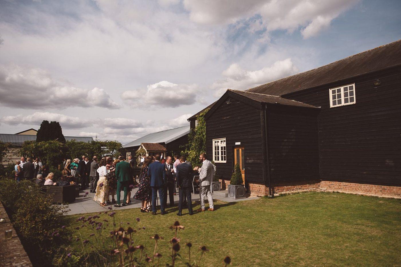 Milling Barn wedding guests enjoying a drink