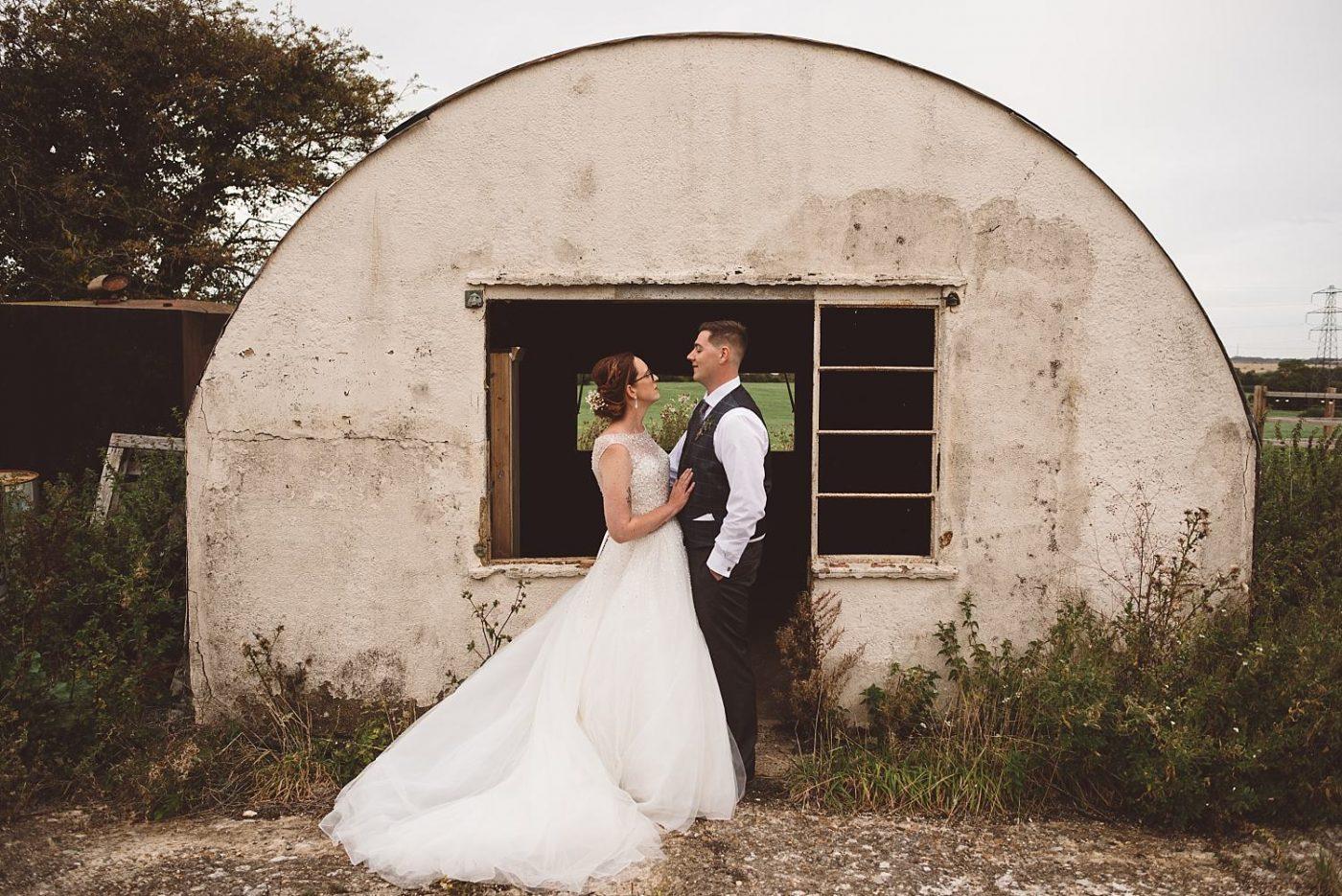 bride and groom rustic wedding portrait at Milling barn