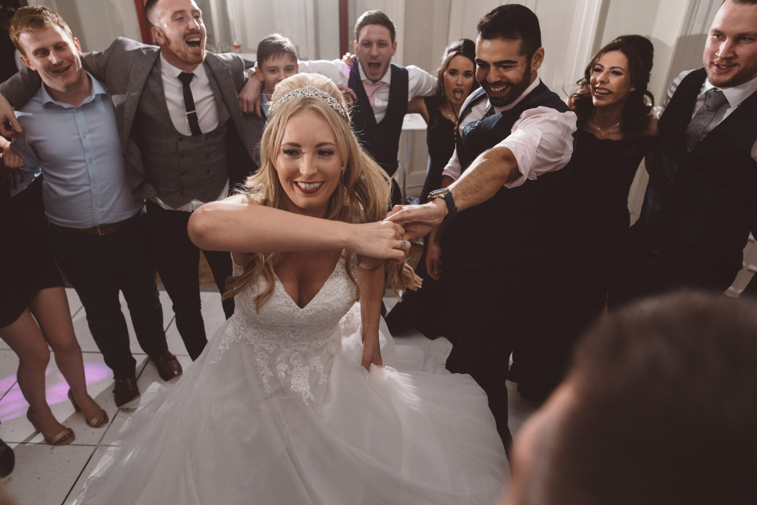 Bride dancing with her friends at an Essex wedding
