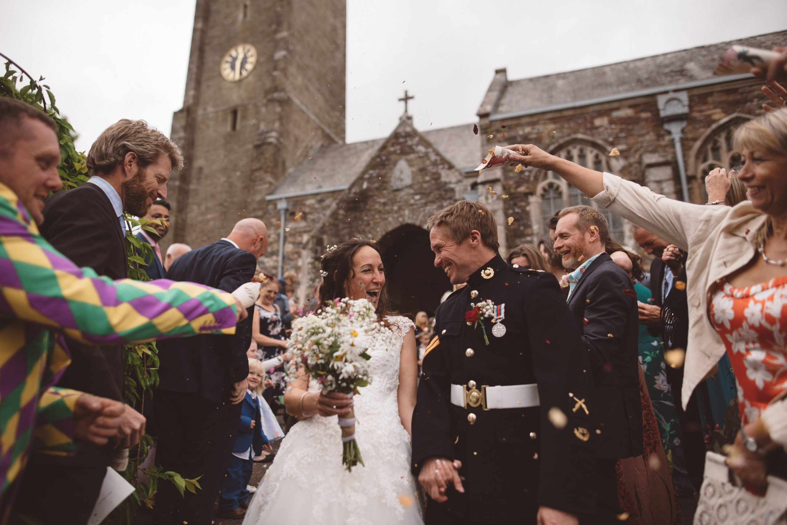 bride and groom walking through confetti at Carswell weddings