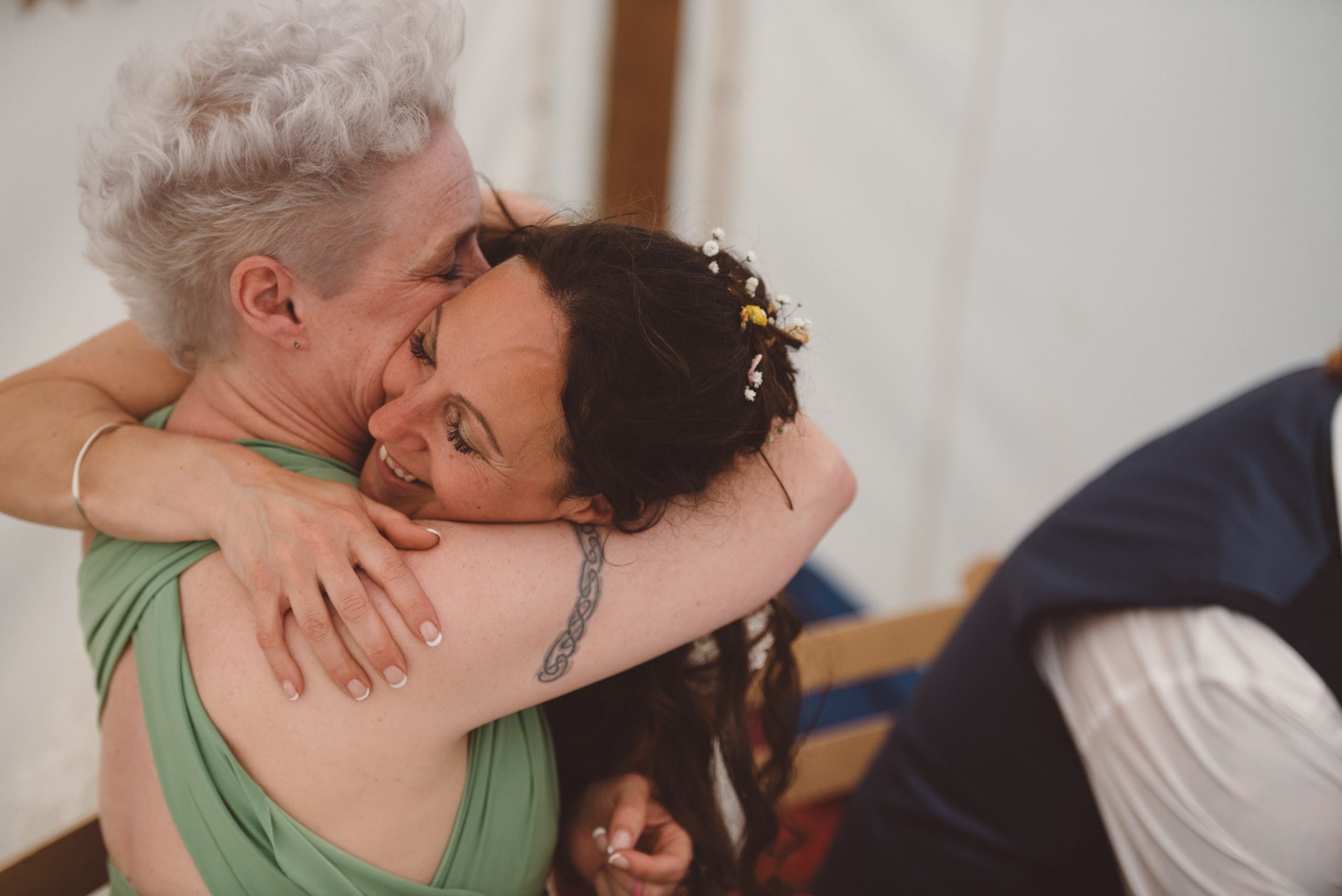 bride hugging her best friend at Carswell wedding