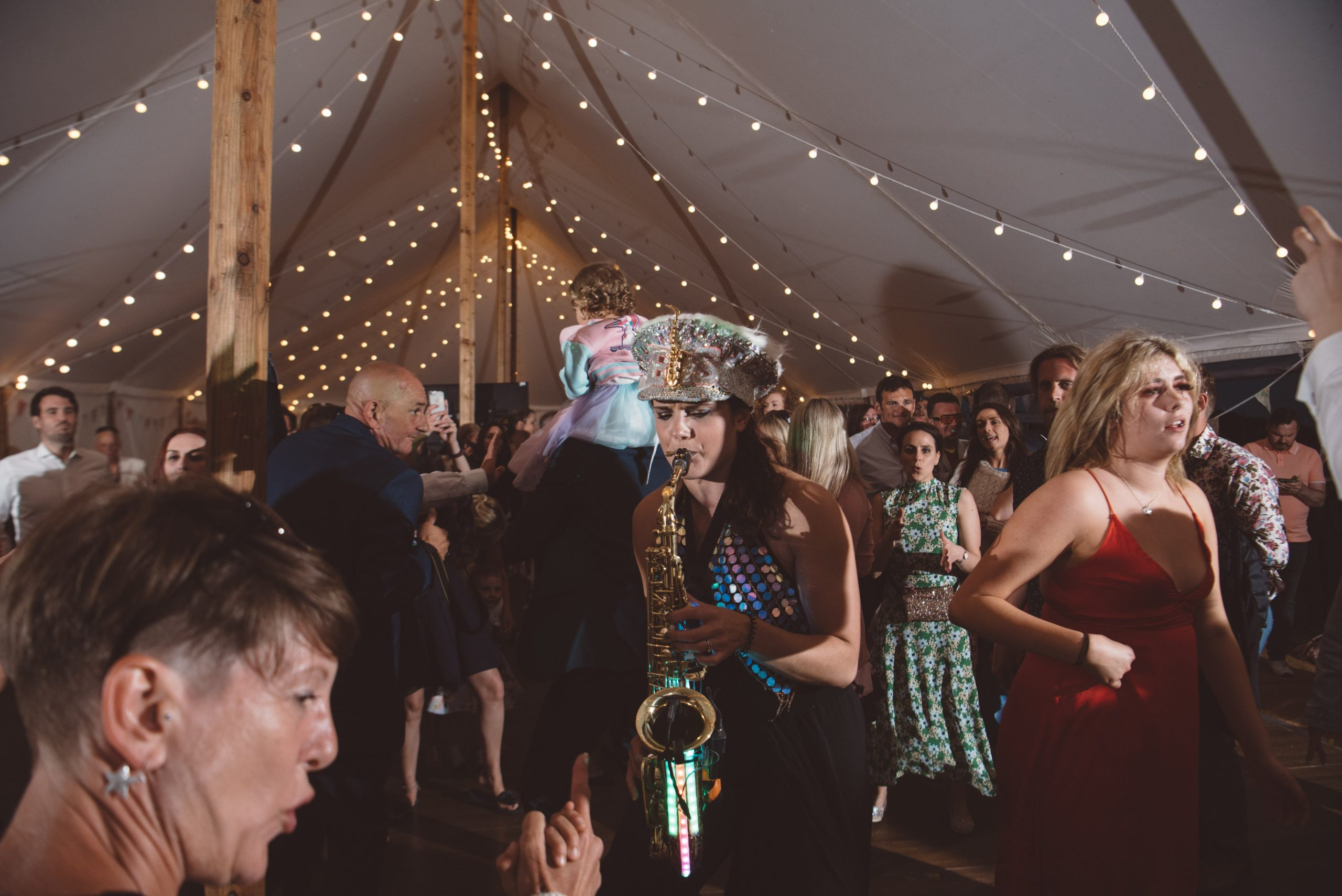 Candid photo of Ellie Sax at Carswell weddings