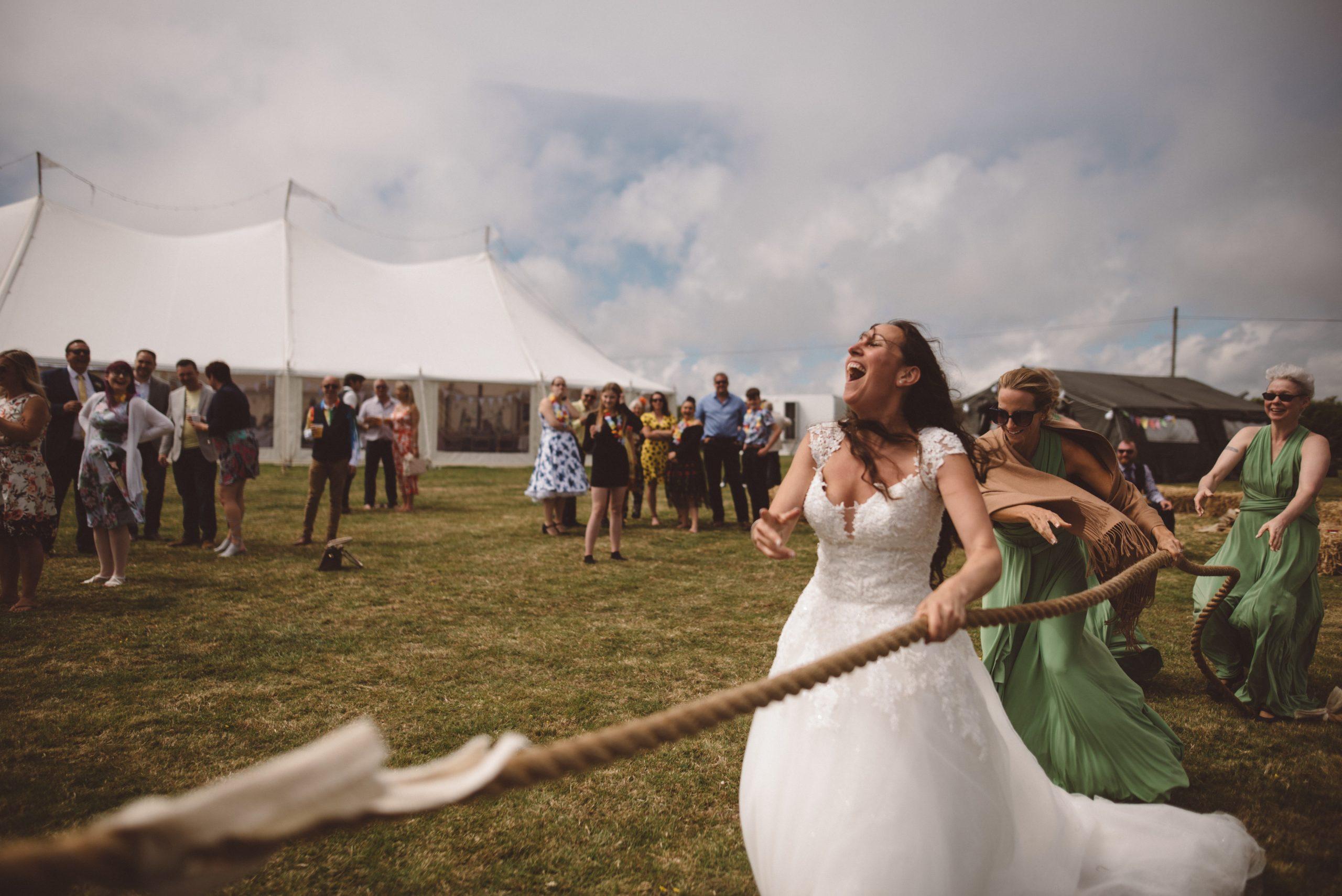 fun tug of war wedding games at Carswell Weddings