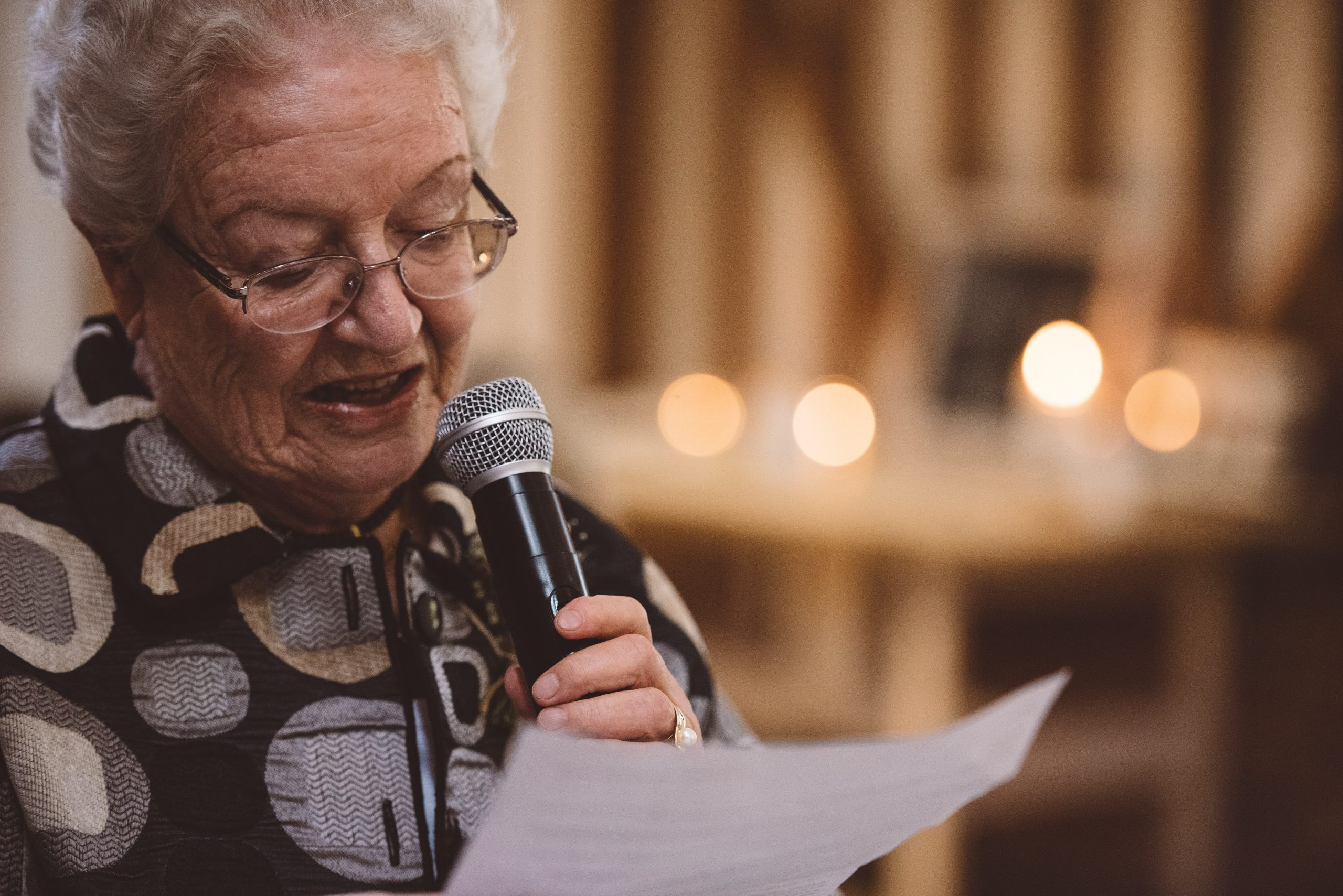 emotional Nan of the bride during speeches in Milling Barn