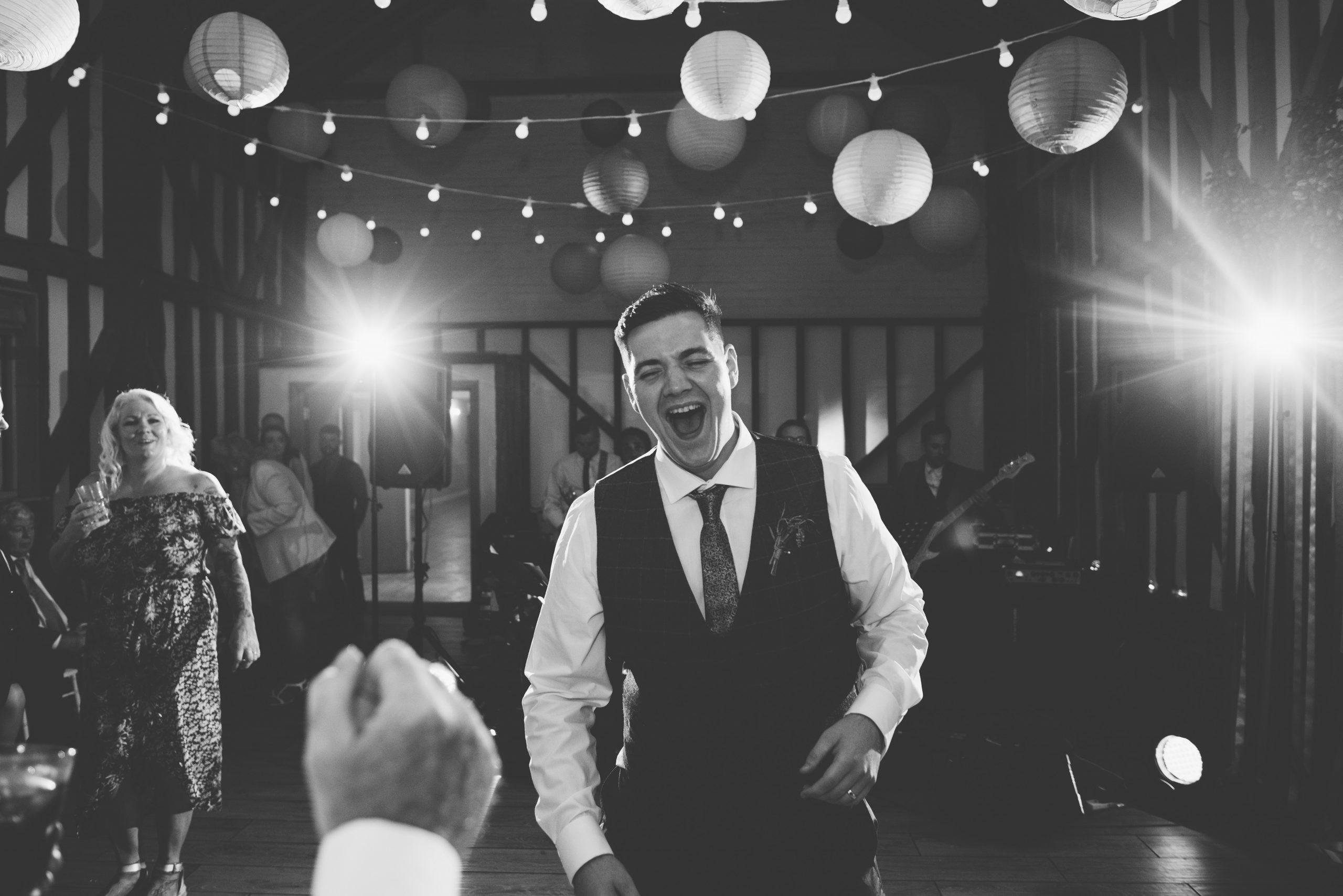 groom dancing under Fleur de Lace wedding details
