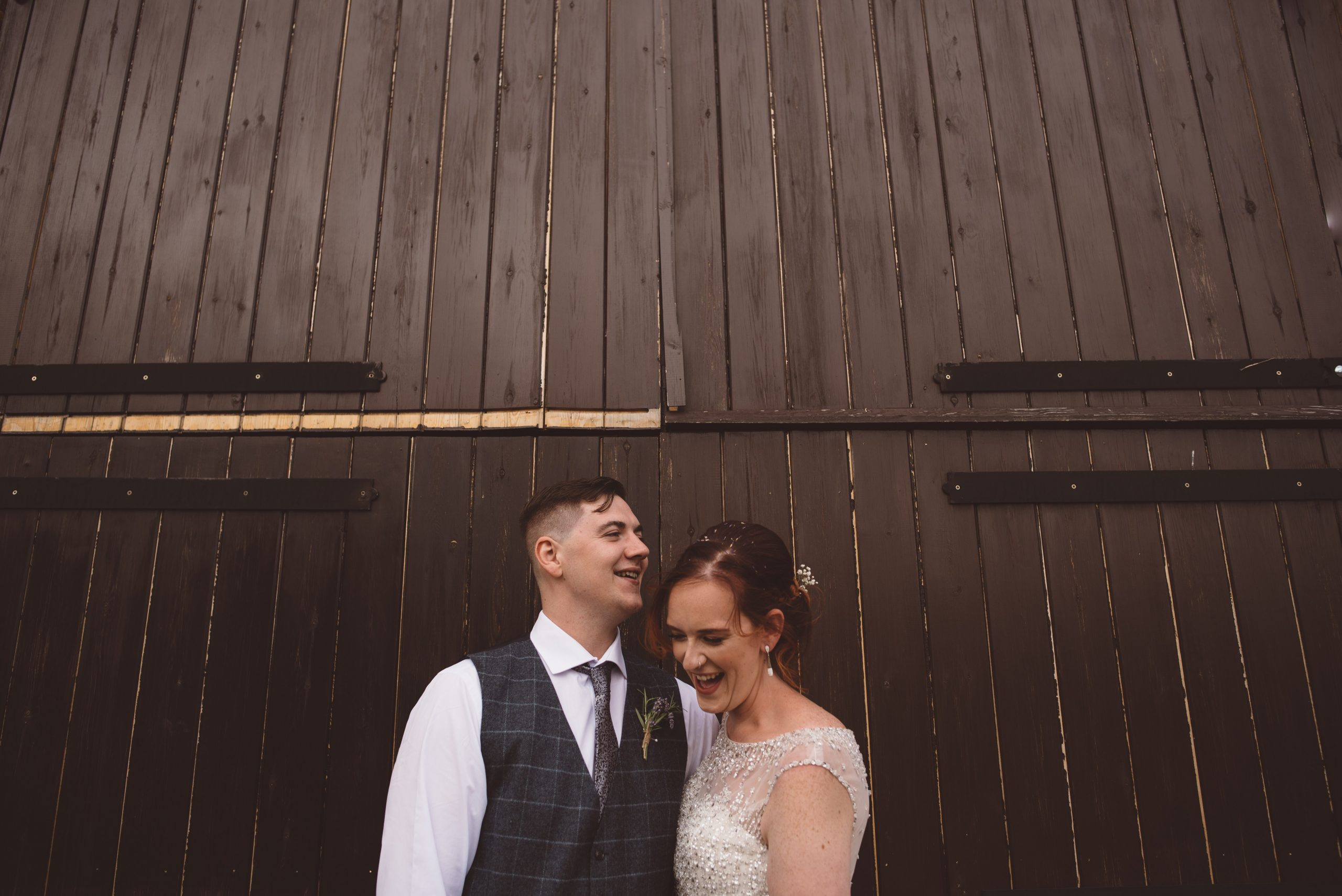Bride and groom rustic photo outside Milling Barn