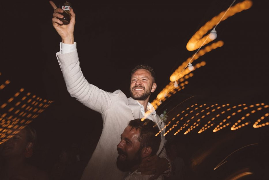 Groom celebrates with his best friend at Ibiza wedding