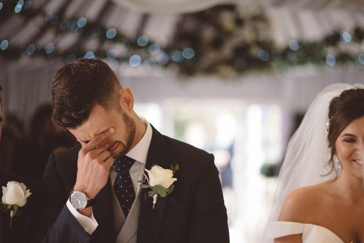 Emotional groom seeing bride at Friern Manor