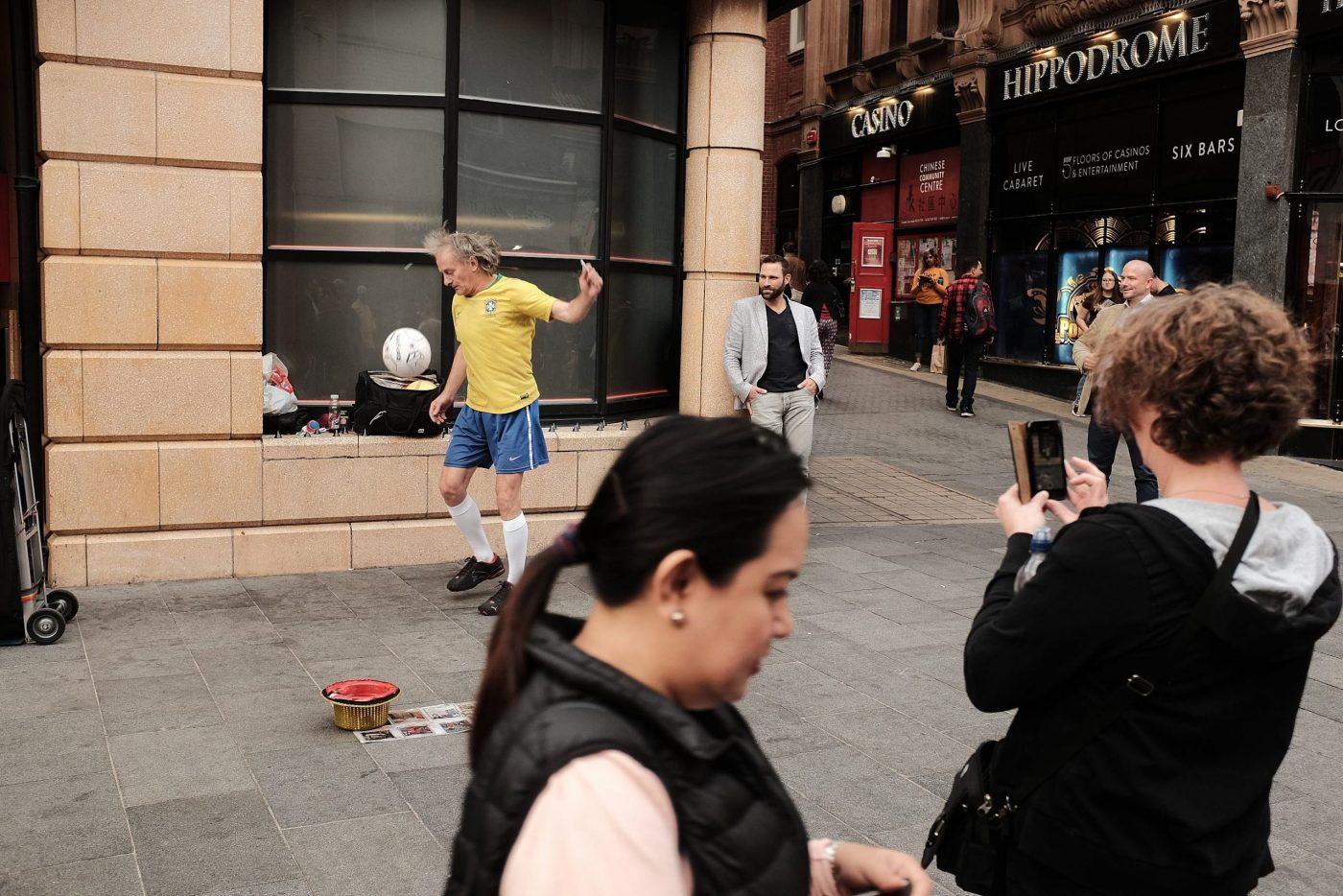 street footballer London showcasing kick ups