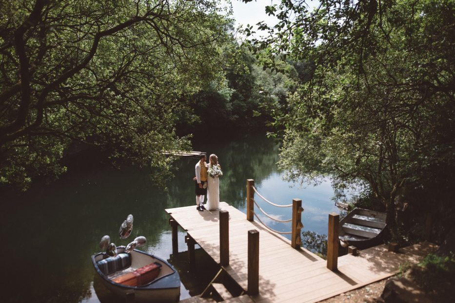 Bride and groom next to lake at Cornish Tipi Weddings