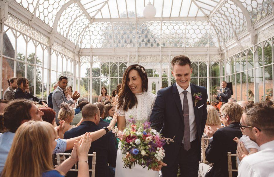 Bride and groom leaving Horniman Museum wedding