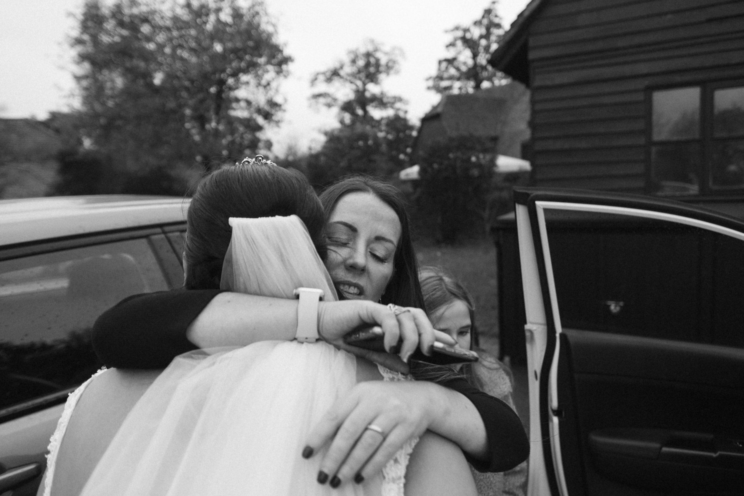 best friend hugging the bride at Essex wedding