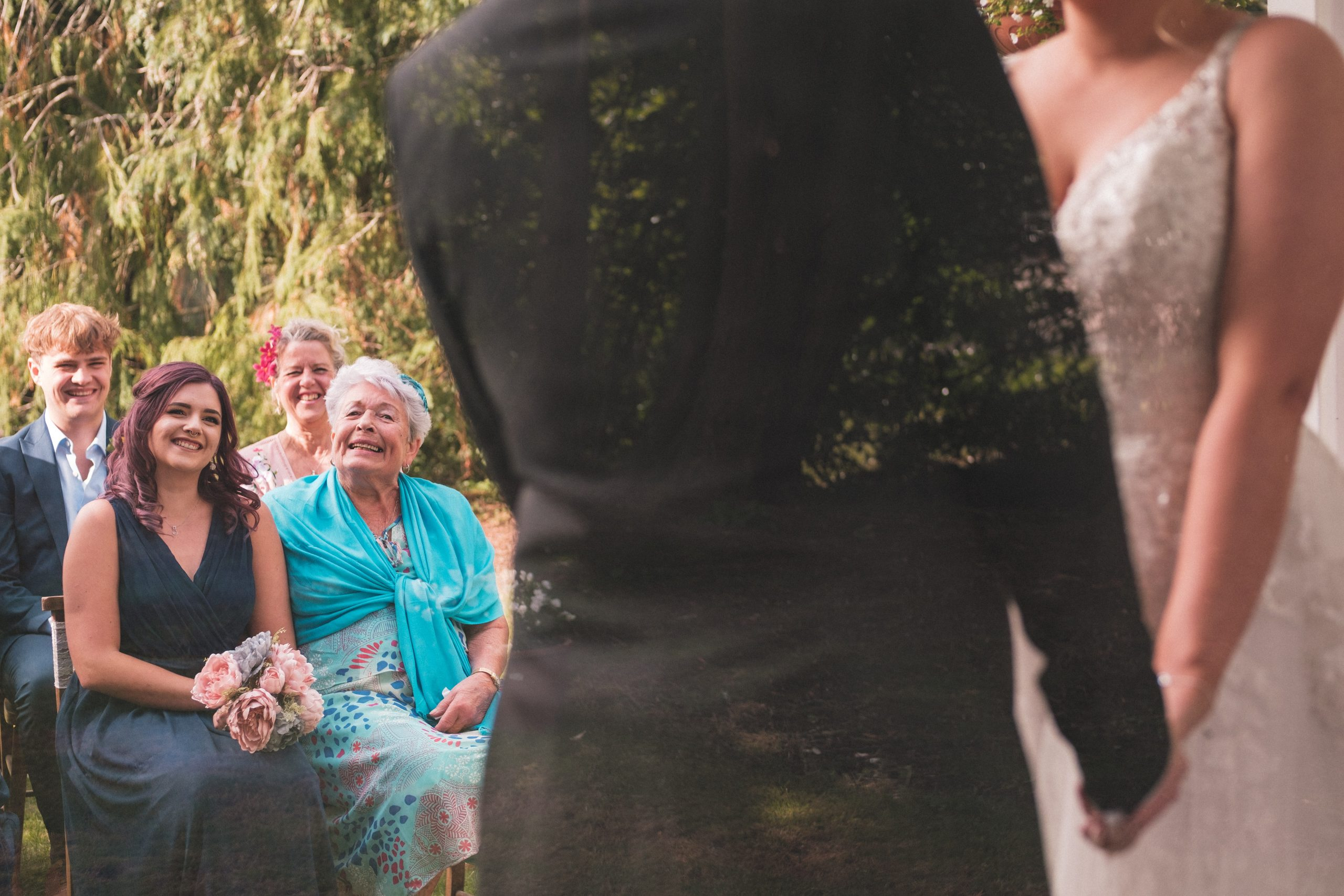 proud Nan looks on at bride during Essex ceremony