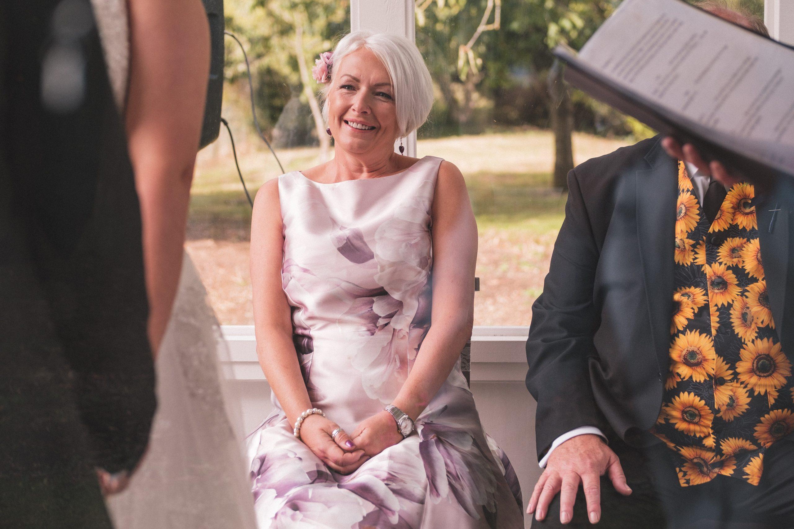Proud Mum looks on at her daughter during Essex wedding