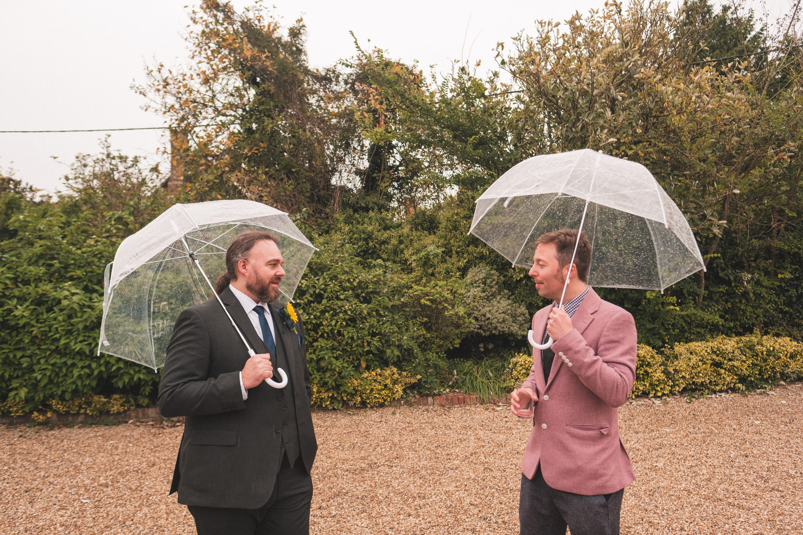 wedding guests in the rain at Essex wedding