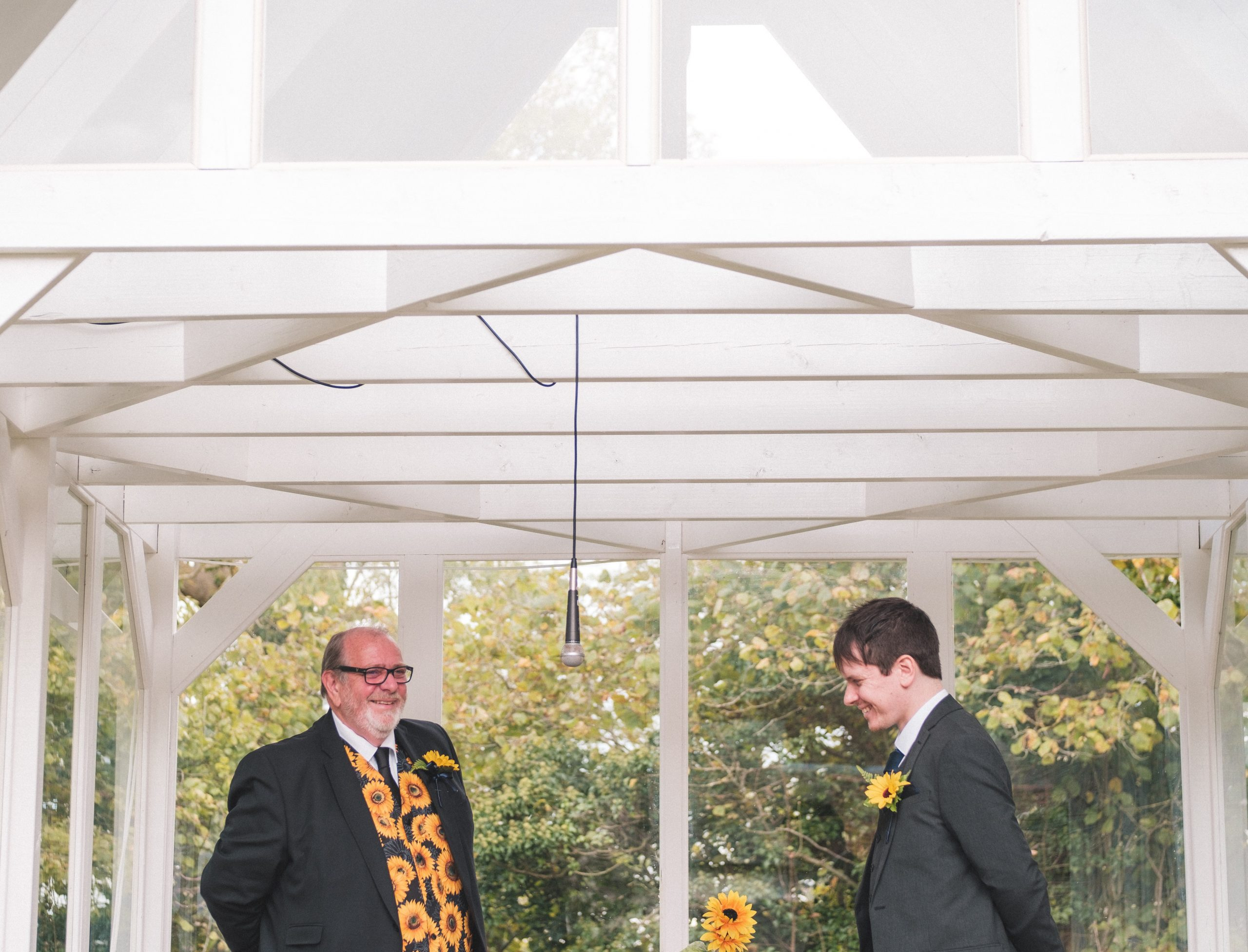 Groom laughing with his Dad at Essex wedding
