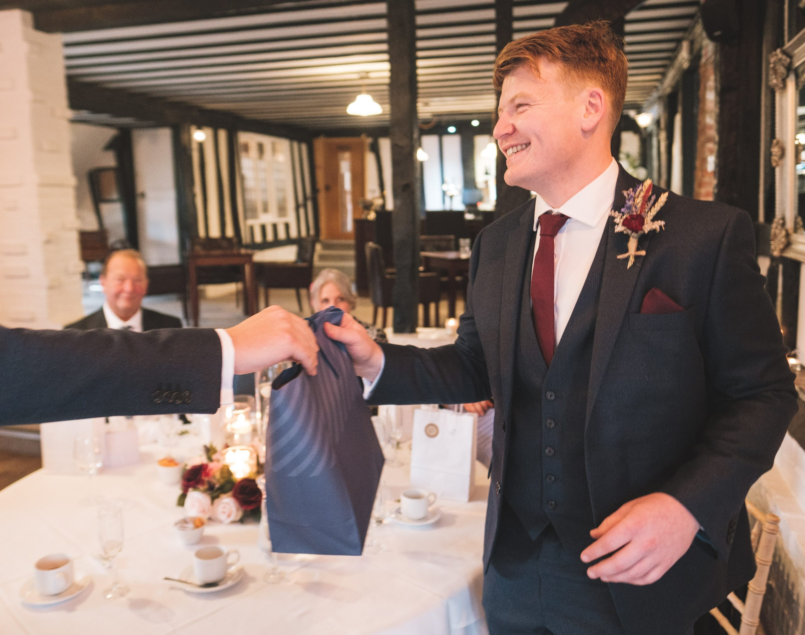 best man receiving gift during Essex reception