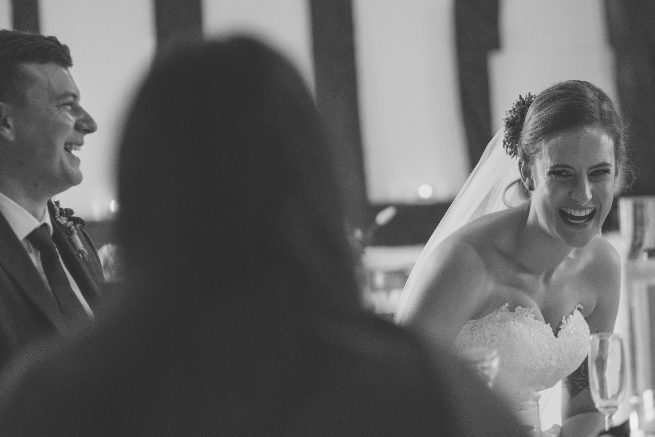 laughing, fun bride during her Essex wedding