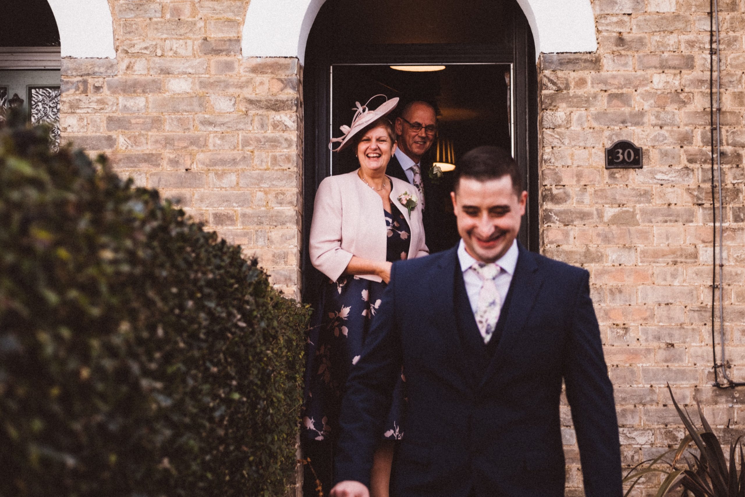 groom with his family at essex wedding