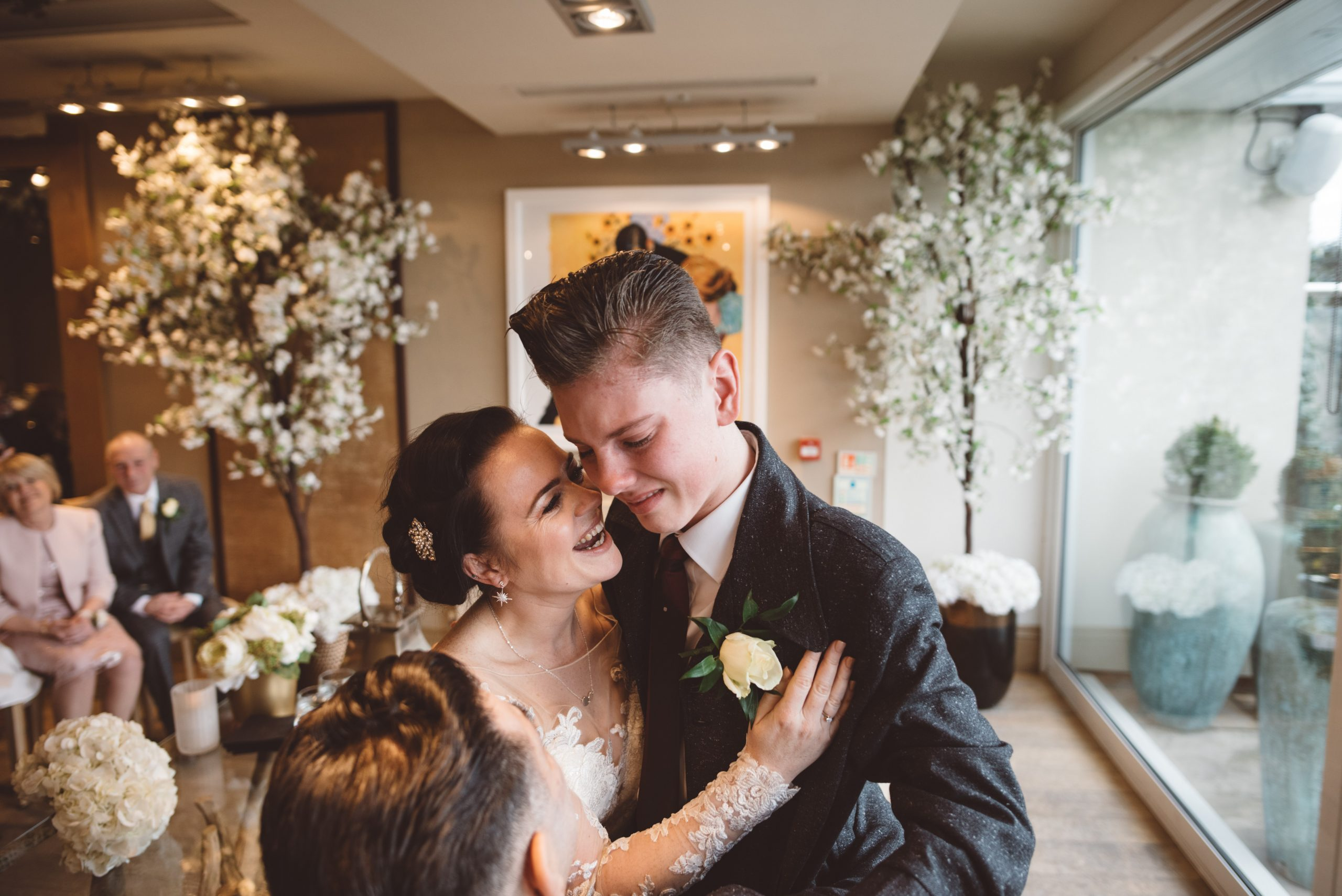 emotional bride with her son at Essex wedding