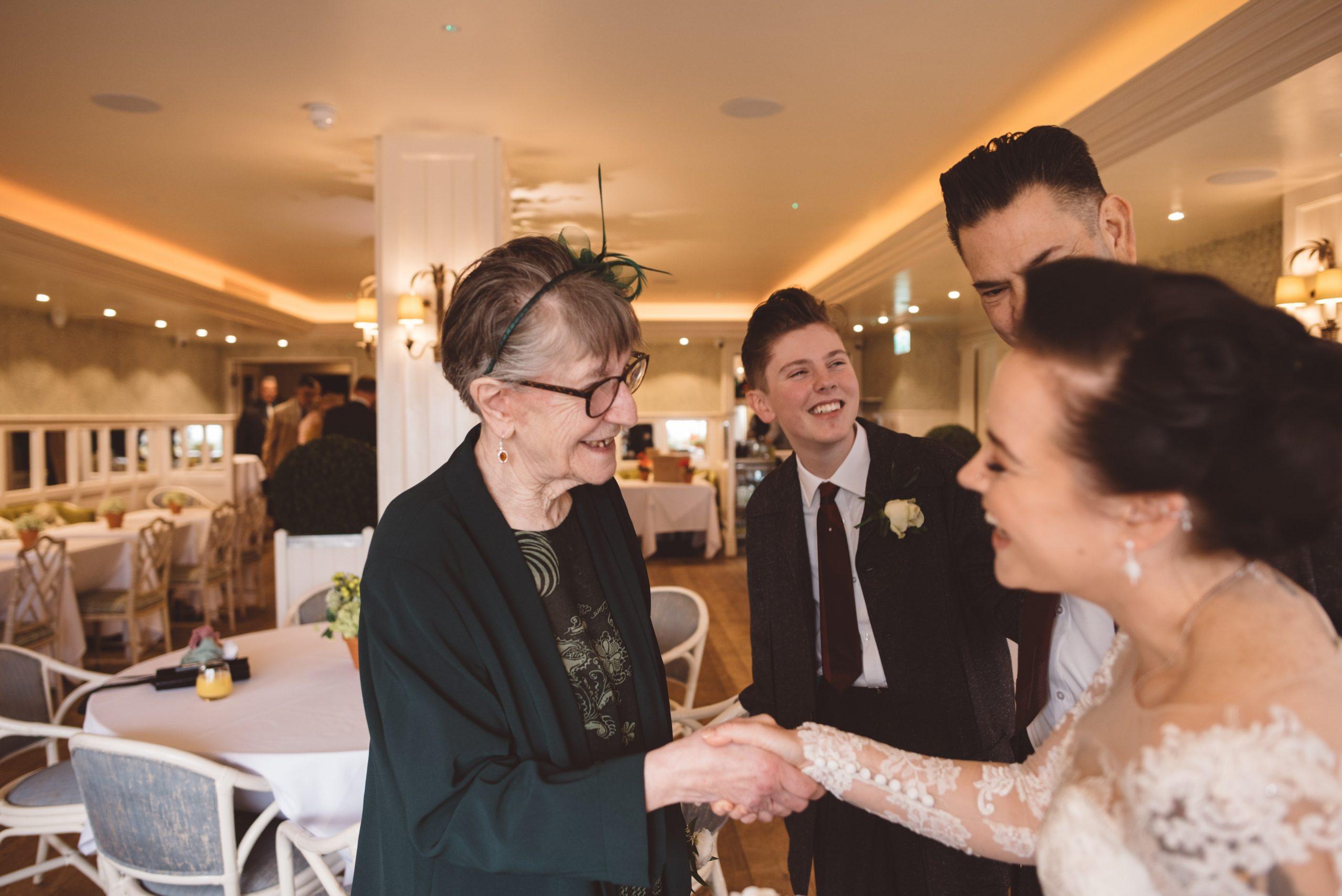 candid wedding moment at roslin beach hotel