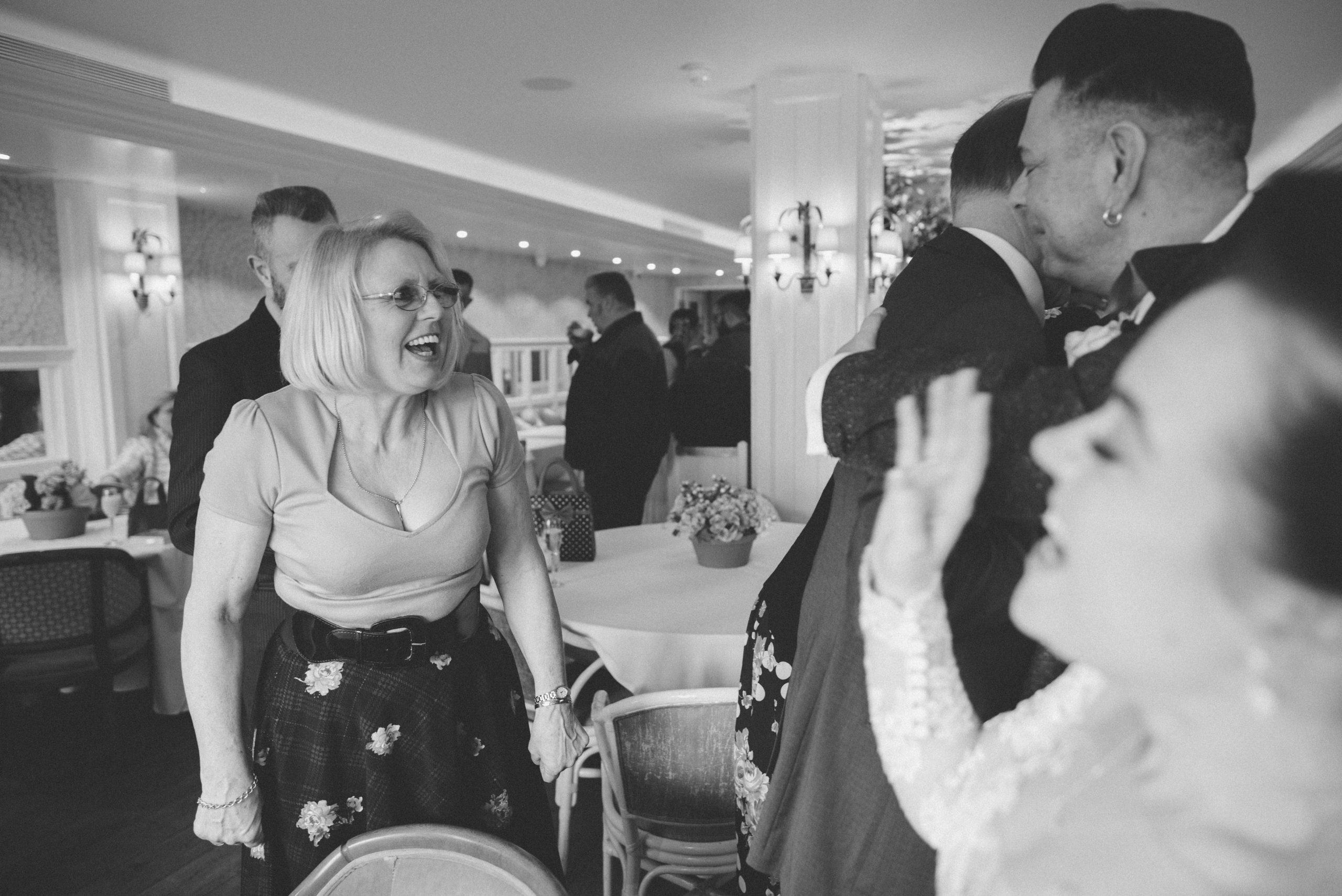 happy bride with her friend at essex wedding
